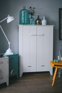 White and cyan home decor with a white wardrobe