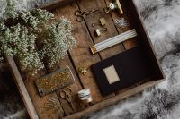 Office accessories on an old wooden tray