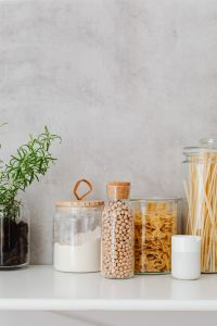 Kaboompics - Farfalle, spaghetti pasta in jars, wheat flour, rosemary and chickpeas