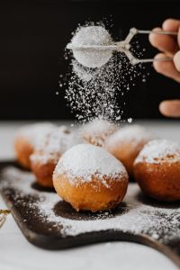 Kaboompics - Homemade Polish doughnuts with cherry filling, covered with powdered sugar. Traditional speciality on Fat Thursday in Poland.