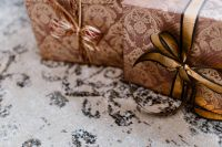 Kaboompics - elegantly wrapped gifts with golden ribbon