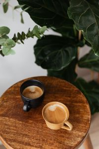 Kaboompics - Cup of coffee on wooden table