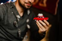 Kaboompics - A handsome man with Christmas presents - toy car