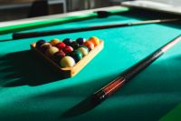 Kaboompics - Billiard balls on green table with billiard cue