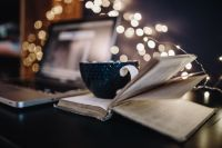 Kaboompics - Cup of coffee, book, fairy lights