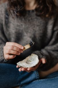 Kaboompics - Clearing Energy In Home Using Palo Santo - Smudge Wood - Healing