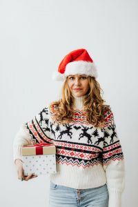 Kaboompics - Woman with Gifts Wearing Christmas Sweater and Santa Hat