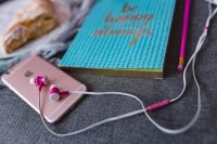 Kaboompics - Blue notebook with a pink iPhone, headphones and a sweet bun