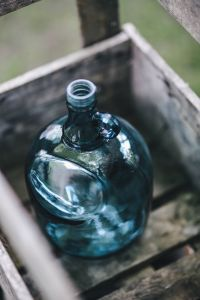 Kaboompics - Cyan decorational bottle in a wooden crate