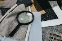 Kaboompics - Magnifying glass with fabric on a table