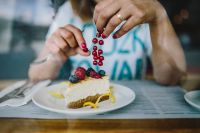 Kaboompics - Woman Enjoying Cheese Cake and a Coffee with Fruits in a Cafeteria