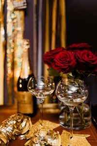 New Year's Eve party - wine glasses, red roses