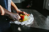 Kaboompics - Woman cutting an apple