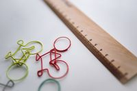Kaboompics - Bicycle paper clips and a wooden ruler