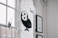 Kaboompics - Little black plastic owls hanging from a ceiling