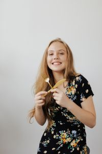 Teen Girl holding cutlery