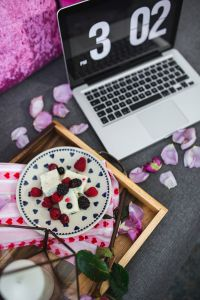 Kaboompics - Summer berries with a sweet dessert on a plate in a drawer and a laptop