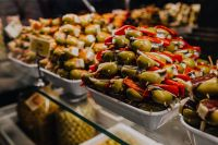 An assortment of olive snacks displayed for sale at San Miguel market.