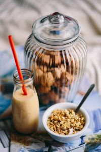 Kaboompics - Jar full of walnuts with a fresh healthy shake and musli in a bowl