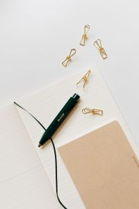 Kaboompics - Pen, clips and notebooks on a white desk
