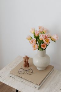 Tulip flowers - candle - book - glasses