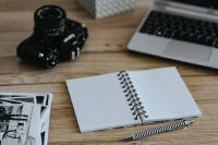 Kaboompics - Black-and-white photos with a silver laptop, a notebook and a camera