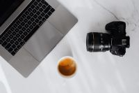 Kaboompics - Coffee, laptop and camera on a white marble table