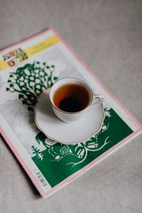 Kaboompics - Cup of tea and newspaper