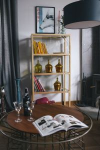 Kaboompics - Stylish home decor with a wooden round table and a bookcase