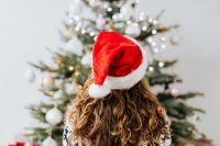 Woman in Santa Hat, Christmas Tree Background