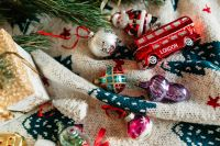 Christmas gift and colourful tree decorations on a blanket