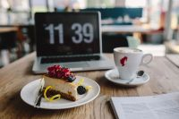 Macbook, iPhone, Magazine, Cheese Cake and Cup of Coffee