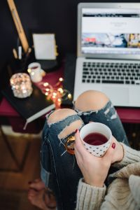 Kaboompics - Woman drinking hot tea in her home office