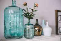 Jugs and flowers on a wardrobe