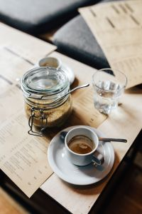 Kaboompics - Morning coffee with a jar of brown sugar and a glass of water