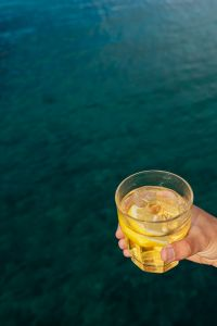 Kaboompics - Yellow summer non-alcoholic drink enjoyed by the sea