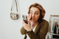 Kaboompics - Woman uses mobile phone