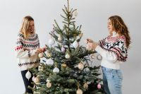 Women Decorate Christmas Trees