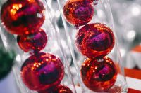 Kaboompics - Red Christmas baubles packed in plastic tubes