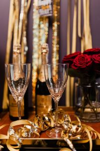 New Year's Eve party - bottle of champagne, glasses & red roses