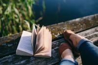 Kaboompics - Reading book at lake