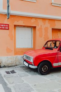 Kaboompics - An old red Renault 4 car parked on the street in Izola, Slovenia