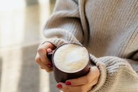 Hands Holding Hot Cup of Coffee