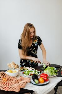 Kaboompics - Teen Girl makes a salad