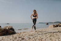 Kaboompics - Woman jogging on the beach