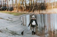 Kaboompics - Woman walking the dog by a lake