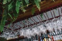 Kaboompics - A big bunch of wine glasses hanging from a holder