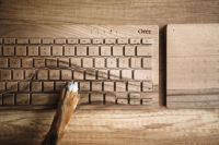 Kaboompics - Dogs paw on the wooden keyboard