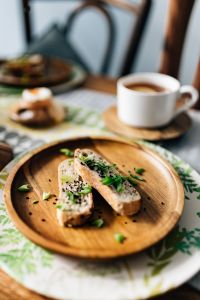 Kaboompics - Breakfast served with tea, bread and eggs