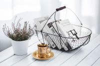 Book basket with a plant and coffee